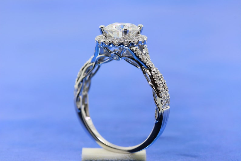 d53348d6518b1 Round 7.0mm Forever One Moissanite Engagement Ring in 18k White Gold. Halo  of Diamonds With Infinity Twisted Band and Filigree Details