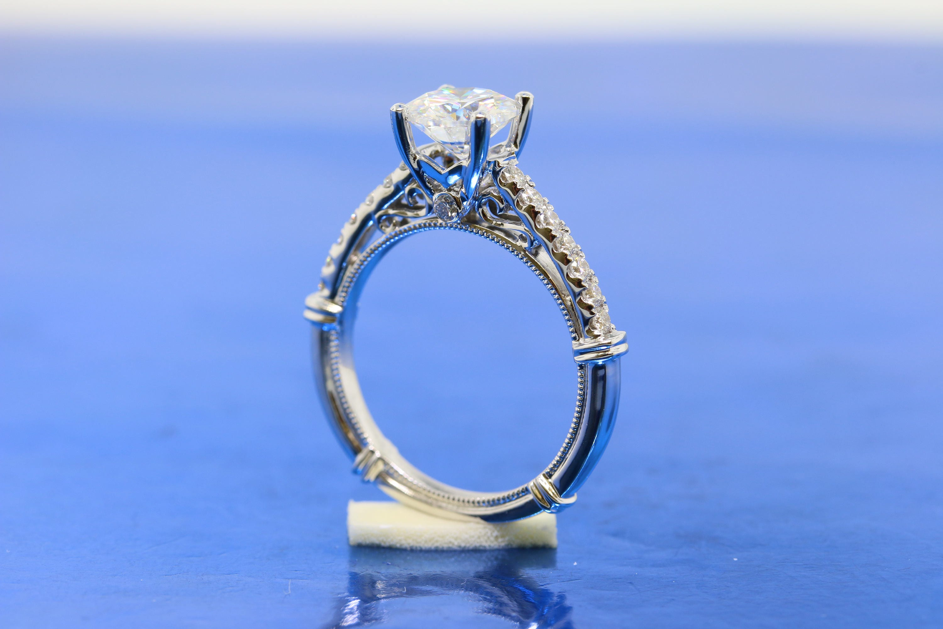 c138317371558 Vintage Inspired Round 7mm Forever One Moissanite Engagement Ring,  Cathedral Setting With Pave Band In 18k White Gold.