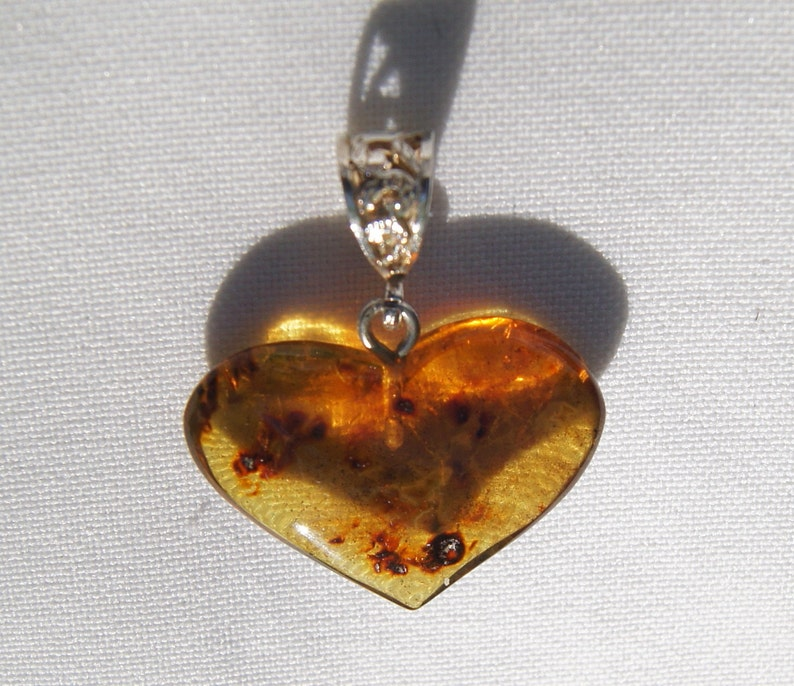Original And Genuine Dominican Heart Shape Red And Bluish Amber .925 Amber Pendant Sterling Silver Reversible Pendant Jewelry