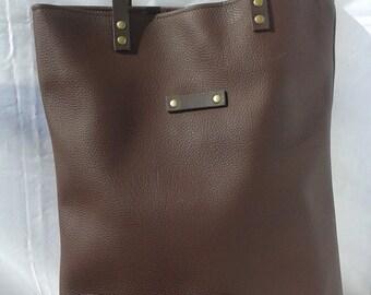 Brown vegan leather tote bag.