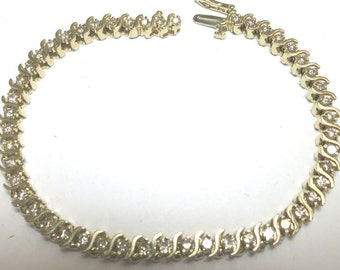 diamond tennis bracelet two carats yellow gold 14k
