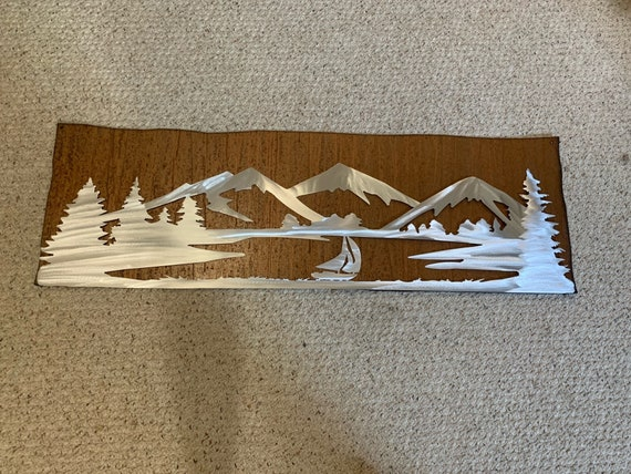 Lake Dillon in silver on the rustic brown background. Size 48x15