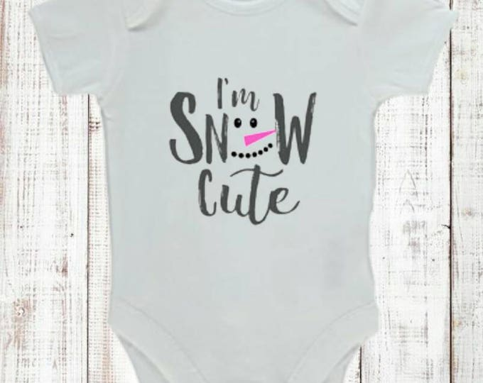"Baby/child vest/bodysuit with ""I'm snow cute"" decoration. Come in sizes 0-24 months. Long or short sleeve. You choose."