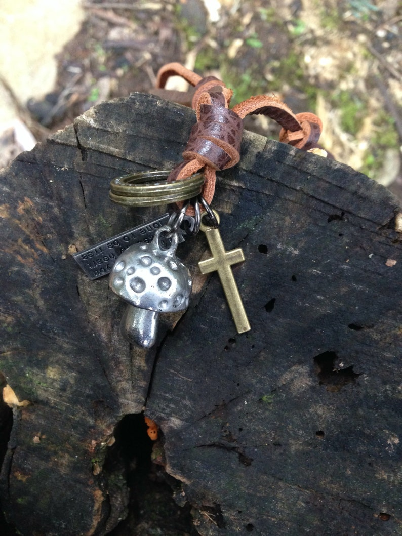 Mushroom necklace with an adjustable brown leather neck strap with rings and crucifix