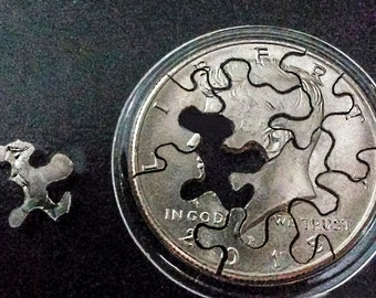 Jigsaw Coin Puzzle in a airtight coin capsule that comes open to play with and  back together, JFK Half