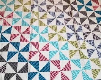 Pinwheel throw quilt