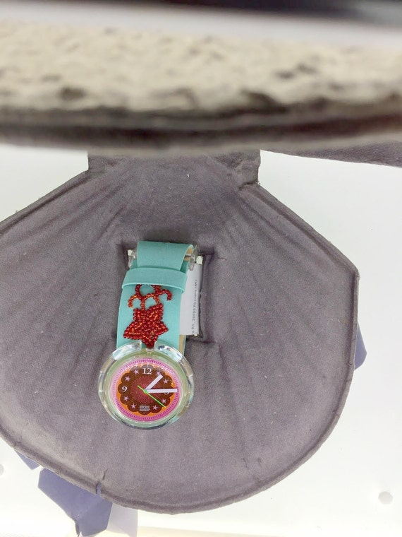 Swatch special soupe de poisson pop swatch clamshe