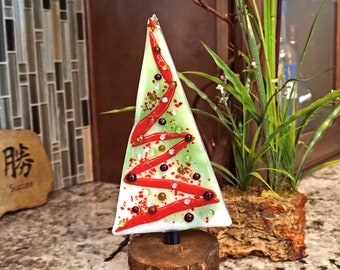 Fused glass Christmas trees on wood