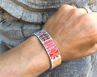 Tiki gods stretch bracelet made of repurposed stainless steel watch band