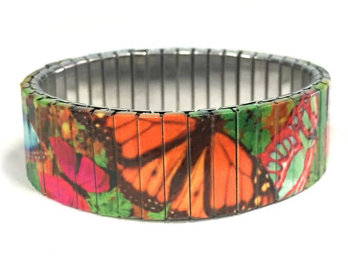 Bracelet with colorful butterflies made of stretchable repurposed stainless steel watch band.
