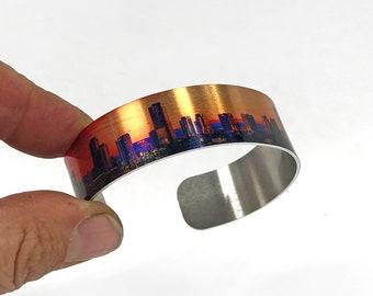 Aluminum Cuff Bracelet with a city skyline design