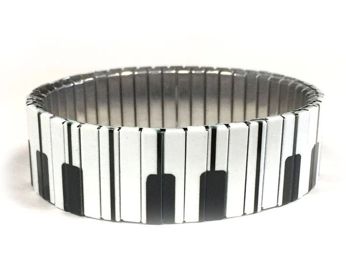 Piano keys stretch bracelet made of repurposed stainless steel watch band