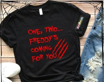 7af143779ea One Two Freddy s Coming For You- Halloween Fun - Nightmare on Elm Street  -Costume- Premium Tee - Unisex or Women s Slim Fit Tee
