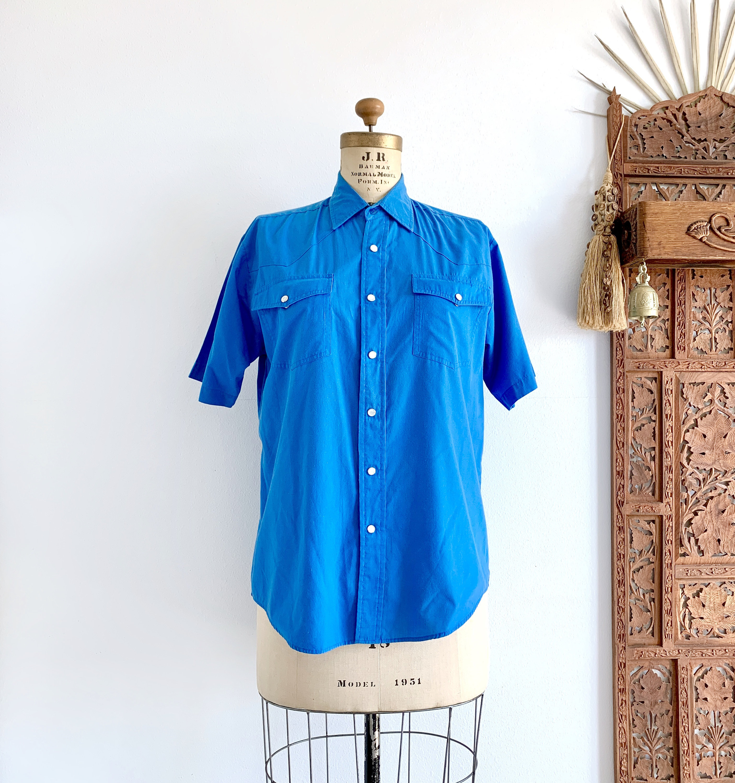 1970s Mens Shirt Styles – Vintage 70s Shirts for Guys 70S Haband Utility ShirtVtg Mens Blue Pearl Snap Short Sleeve Work Shirt70S Factory Uniform ShirtSize M44Chest10Sleeve31Long $0.00 AT vintagedancer.com