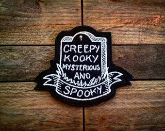 Spooky Glow Patch Addams Family Inspired Creepy Kooky Mysterious   Spooky  Horror Geek Grave Tombstone Scary Gothic Embroidered Badge d864bd101eb5