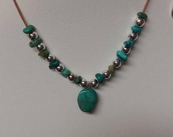 TURQUOISE Nugget and SILVER Beaded Necklace on LEATHER strand.  Silver Eternity Clasp.
