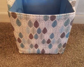 Large Fabric Storage Basket. 100% Cotton Designer Fabric with Lovely Blue Grey and White Leaves on White. Fully Lined with Sky Blue.