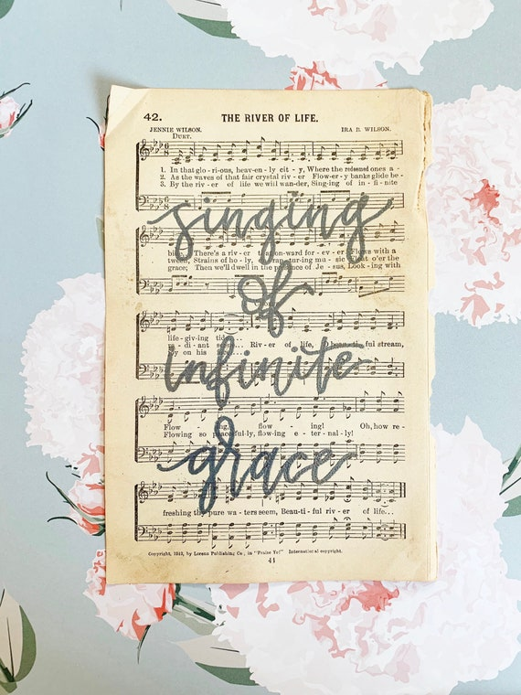 "Original Hand Lettering Vintage Hymnal Page - Embossed on Page ""Singing of infinite grace"""