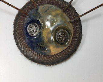 Bobby, ceramic and found object sculpture, mask, wall art