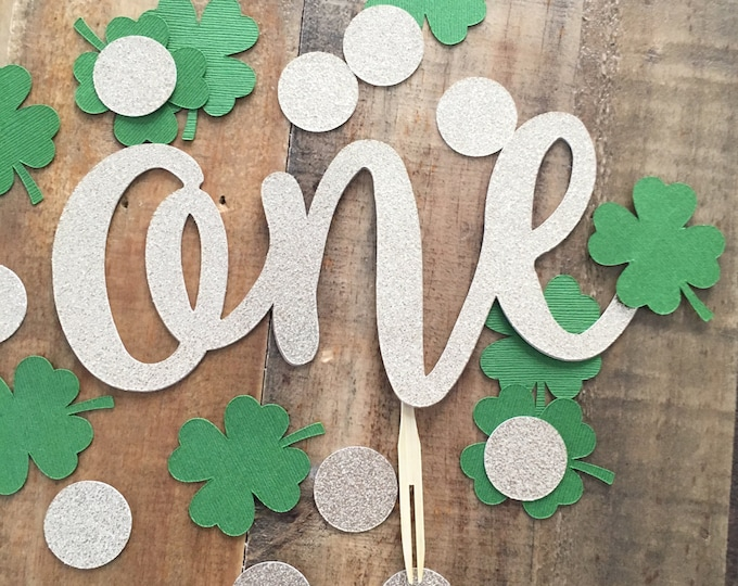 Featured listing image: St Patrick's Day ONE Cake Topper- First Birthday Party Cake Topper! Gold Glitter Irish Cake Topper- Four Leaf Clover