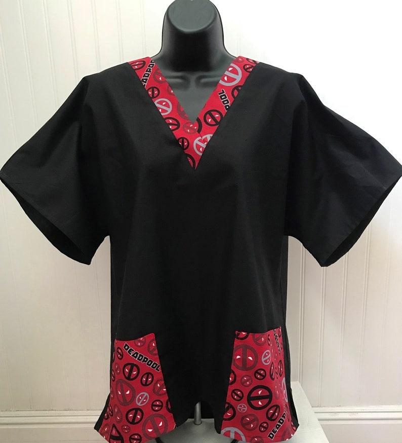 65230058b45 XMen Deadpool Faces Pockets and or VNeck on Black scrub shirt   Etsy