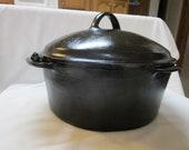 rare vintage cast iron Wagner (8T) on bottom Dutch oven 4qt.