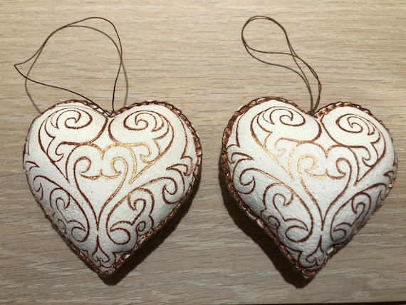 4 beautiful copper hearts, hand made sheepskin interior ornaments