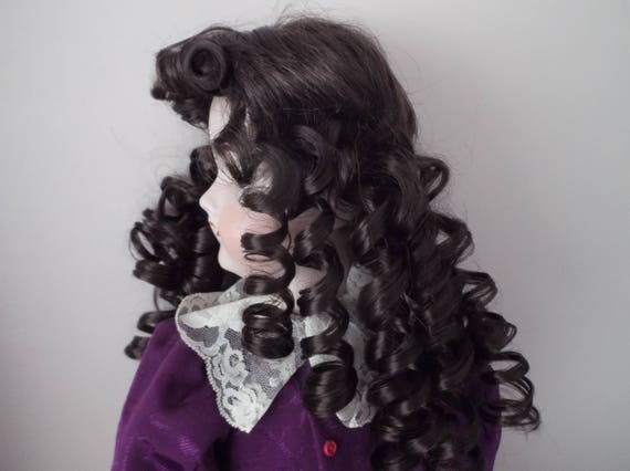 11-12 inch ECONOMY DOLLS WIG IN CURLY BUNCHES DARK BROWN