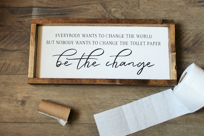 Everyone wants to change the world bathroom sign  Be the image 0