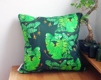 Large Leaves Square Cushion With a Tropical Jungle Print Showing Big Mostersa and Banana Leaves
