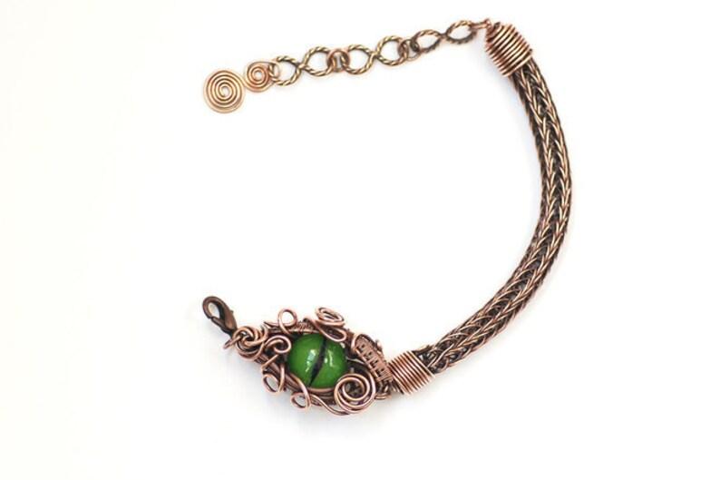Dragon eye antiqued copper viking weave bracelet