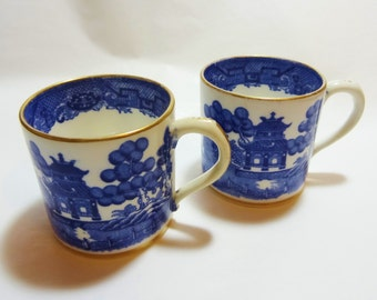Pair of Antique Coffee Cans or Cups. Demitasse Coffee Cups Vintage Blue and White Transfer Pattern with Gilding to Rim, Base and Handles