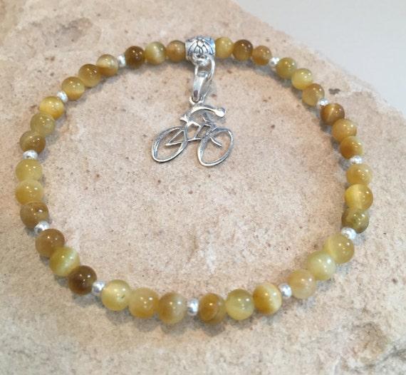 Amber bracelet, bracelet for cyclist, bracelet for athlete, tiger eye bracelet, charm bracelet, stretch bracelet, bike charm, bike bracelet