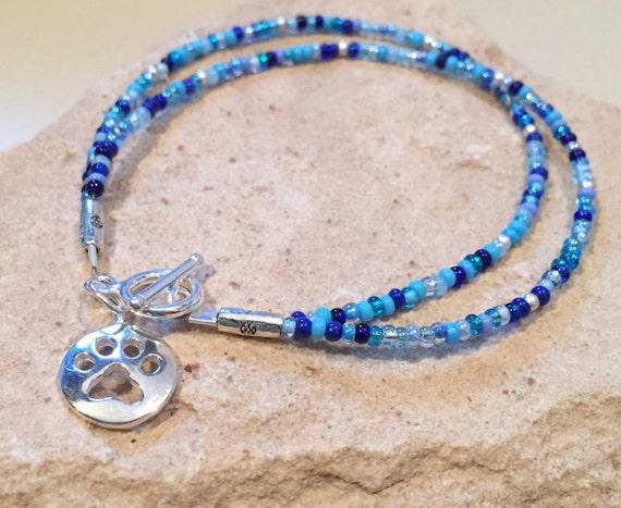 Blue bracelet, gift for dog lover, bracelet for dog lover, charm bracelet, seed bead bracelet, sterling silver bracelet, paw charm, boho