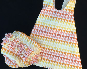 Baby and toddler clothing, reversible pinafore dress, baby girl dress