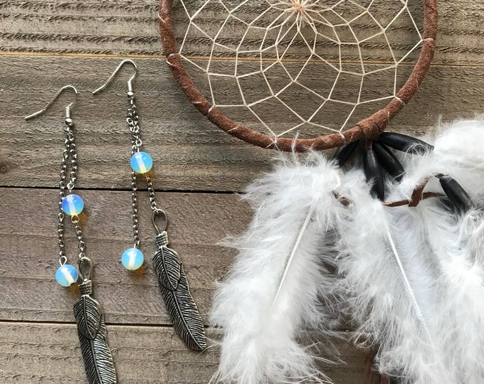 Lightweight feather charm earrings with moonstone beads.