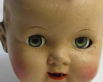 Large Creepy Head of Sleepy Eye Doll Eating Bugs