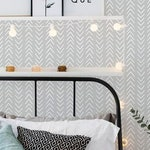 Peel and stick wallpaper with white herringbone pattern on a grey background, Wall sticker with herringbone pattern, Scandinavian wallpaper