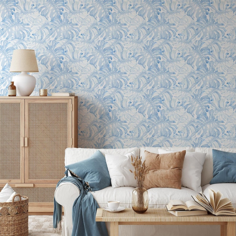 Removable wallpaper with baby blue monstera leaves pattern image 1
