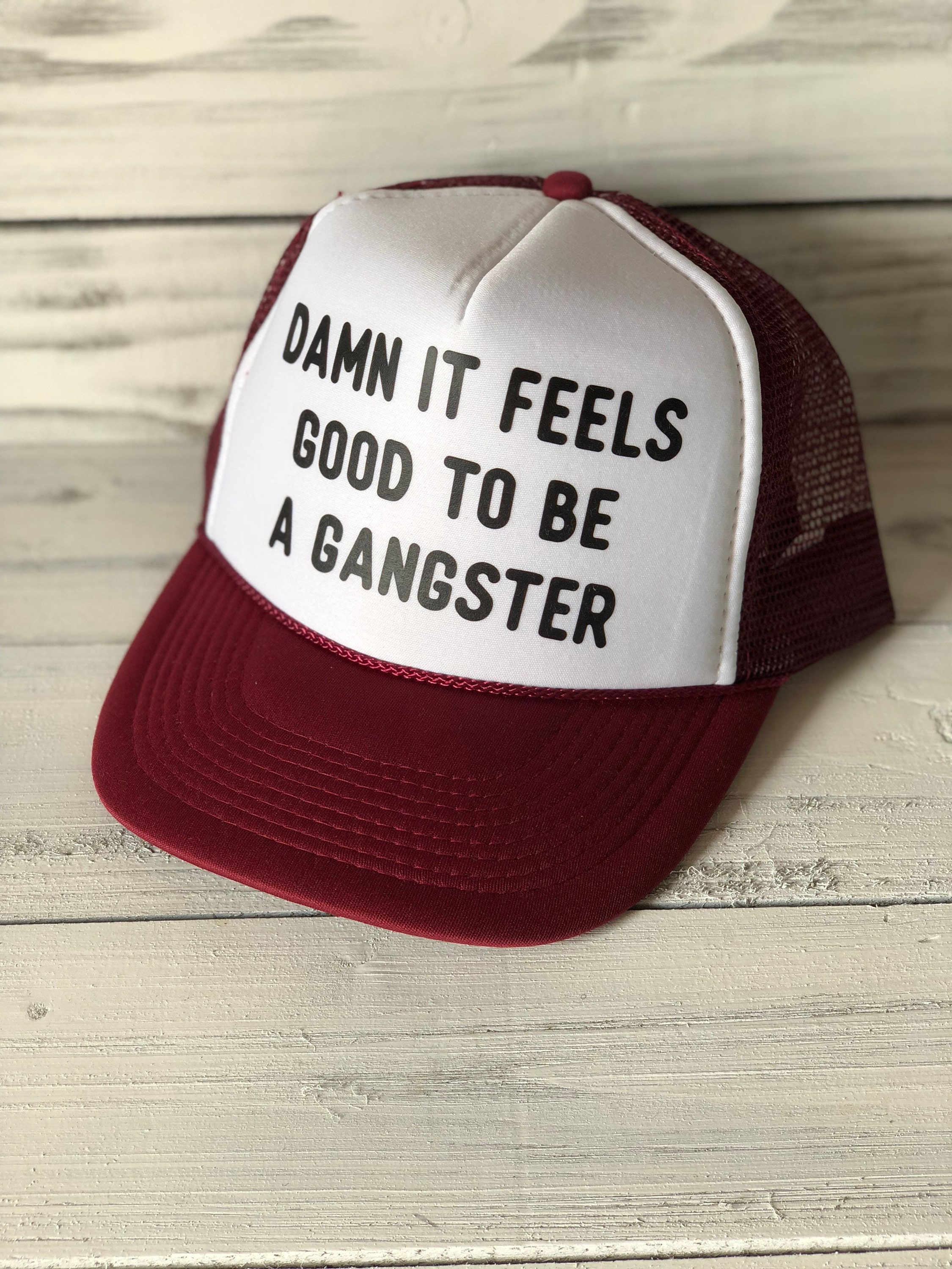 52ba8021642 Damn It Feels Good To Be A Gangster Trucker Hat