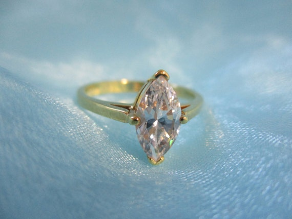 CZ Solitaire Gold Tone Ring - image 1