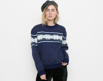Knitwear blue sweater with stars. Warm cozy  winter themed oversize Christmas long sleeved pullover jumper .