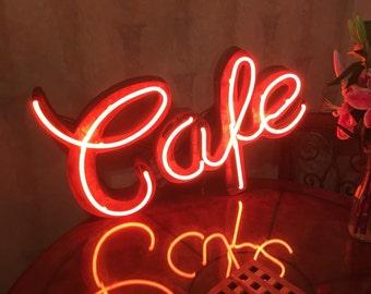 Vintge Cafe neon sign on rusty tin surround