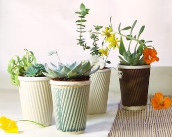 Ceramic planter for succulent pot plants. Also perfect as a cactus pot. Or a tea cup!