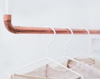 Design coat bar by rod & knot – THE COPPERROPE hanging from copper and cotton rope (white), ceiling fastening, design coat rack