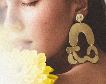 Arched abstract earrings in gold leather