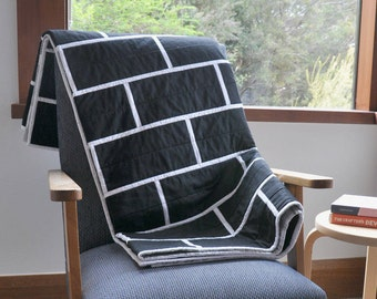 Modern black and white quilt. Brick tile design patchwork quilt. Minimalist. Monochrome. Handmade quilted throw. Quality made bed linen.