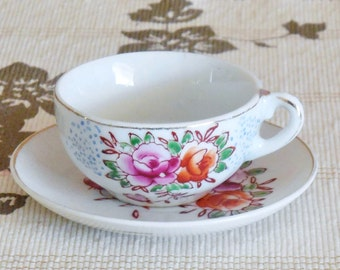 Japanese floral bone china demitasse tea cup and saucer duo 1950s