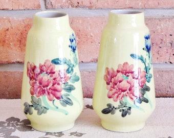 West German unmarked vintage pair of yellow vases, floral design, 1950s