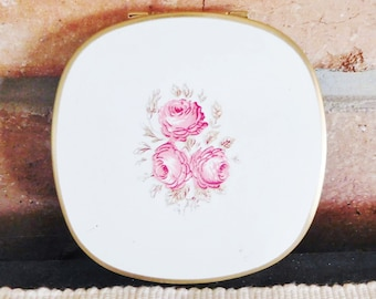 White enamel compact with mirror, rose motif, vintage 1950s, original labels intact, collectible, made in England